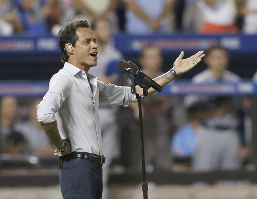 Marc Anthony sings God Bless America during the seventh inning stretch at Major League Baseball's All-Star Game in New York